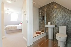 Patterns are not just for living rooms.  Off set a minimalist bathroom with a touch of decadence! From a showhome