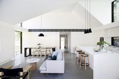 A rear extension to a 1930s Californian Bungalow in Sydney's North Shore delivers a new light-filled living and kitchen space under a simple shed-like structure.