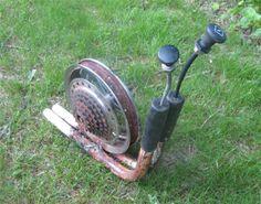 Original Vicki - snail - made from handle-bars, bike tire rim, bicycle gears, and choke levers
