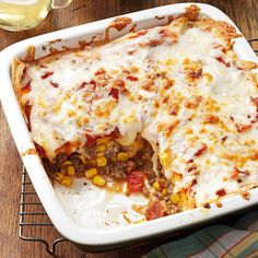 Spicy Enchilada Casserole Recipe -This zippy Mexican casserole is a real winner at our house. It's so flavorful and filling, we usually just accompany it with rice and black beans. If your family has spicier tastes, increase the chili powder and use a medium or hot salsa.—Julie Huffman, New Lebanon, Ohio