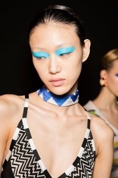 Missoni Beauty S/S '16. Big bright wash of neon to top eyelid. Minimal makeup and hair elsewhere