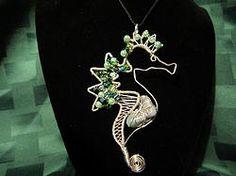 Natural Emerald Seahorse Wire Wrap Pendant