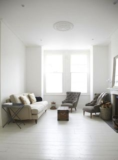 In the living room, a pair of gray upholstered Sark Armchairs and a classic Bluebell Sofa, both from Sofa.com.