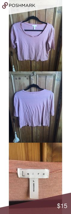 Leith Crop Top Super cute Leith crop top. Small cut outs at neckline and hem give it a distressed look. Perfect with high rise shorts or jeans :) Size is large but would fit a small or medium for an oversized/baggy look. Leith Tops Crop Tops