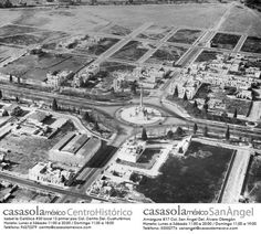 Sugerimos que era una tarde de otoño cuando se tomó esta fotografía aérea dónde se muestra el Ángel de la Independencia a principios del siglo XX, a sólo 2 años de su inauguración, 1912. México.