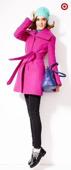 Team a pink wrap coat with a bright knit hat for a playful, brave-the-elements look.