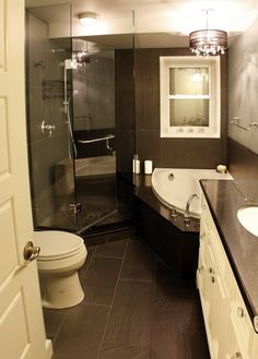 too dark, but a great use of space for a tub and separate shower. Shape of tub makes it work.