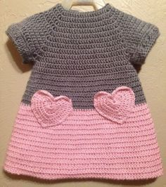 """I like the idea of crocheting a heart and making it into a pocket on a fabric shirt/skirt/dress. [ """"Soft & Beautiful Crocheted Pink and Grey Baby Toddler Dress Heart Pockets…"""", """"Color idea only."""", """"Lily by Michael Sodeau for Modus"""" ] # # # # # # # # # Crochet Baby Clothes, Crochet Girls, Crochet For Kids, Knit Crochet, Crochet Children, Baby Patterns, Knitting Patterns, Crochet Patterns, Baby Sweaters"""