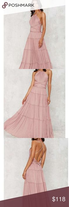 Nasty gal Mauve Bacall Chiffon Dress You're about to have more than just a moment. The Bacall Dress is made in mauve chiffon and features a halter neck, tiered skirt, full maxi silhouette, strappy detailing, and accordion pleats throughout. Perfect for a wedding, weekend getaway, or holiday party. By Nasty Gal.  *Zip/hook and tie closure at back  *Strappy detailing  *Lined  *Polyester  *Runs true to size  *Hand wash cold  *Imported Nasty Gal Dresses Maxi