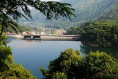 Vehicles passing through the dam cum bridge at Umium Lake. It is this man made barricade that holds the water together. #Shillong