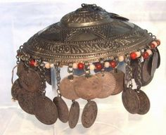"Strikingly executed fine silver museum quality 18th Century Ottoman bridal headdress features outstanding master artisan repousse chasing and 52 coins. The period coins include mostly attrib. 17th - 18th Century silver Ottoman coins, likely including Gurush, Yirmilik, and Paras as well as a rare 17th - 18th Century Holy Roman Empire (Prussian/Austrian) (neighboring empire to the Ottomans) - Groschen silver coin. Dimensions: approx. 6"" diameter. The one Austrian coin may be worth $100 alone."