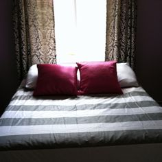 West Elm gray and white striped duvet cover with hot pink pillows!