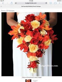 Fall bouquet, silk flowers I don't want the cascading look - but I would love to have a bouquet w/ maple leaves and dark roses! -MZ