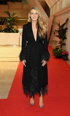 Quick costume change in Cannes! Following the premiere of her Woody Allen film, Blake Lively swapped her Versace gown for a feathered, plunging Salvatore Ferragamo coat dress to attend the festival's opening night gala dinner.