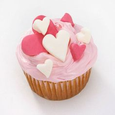 Gathered Hearts Cupcake  Get to the heart of the season. Pink-frosted cupcakes topped with fondant hearts overflow with Valentine wishes.  More cute cupcake ideas: http://www.bhg.com/holidays/valentines-day/recipes/valentines-day-cupcake-recipes/#page=3