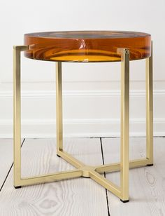McCollin Bryan, Contemporary, United Kingdom Tinted lens table with acrylic top and brass base.  H39 x Ø35cm