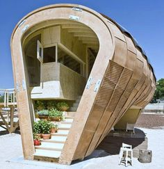 Solar Energy Design The Fab Lab House By IAAC- The Fab Lab house by the Institute for Advanced Architecture of Catalonia (IAAC) was designed as an entry into the 2010 Solar Decathlon Europe competition. This house, aim to disseminate among the general public the benefits of using renewable energies, especially solar energy. The Solar FabLab house rounded shape is positioned for suitable solar tracking and for maximum internal volume with minimal exterior surface.