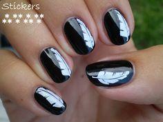 Black polish + white feathers