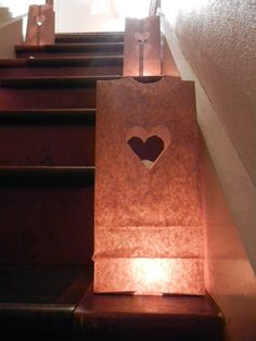 Bachelorette Party Decor:    Lining the stairway with paper bags, cut out hearts, filled with a tea candle.    for @Morgan Busch 's Party! :)