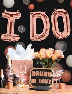 12 Bachelorette Party Ideas: #5. A pink champagne bar with large balloons and glitter bottles