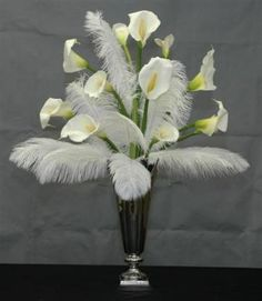 LOL, the only thing I'm getting from this is DRAG QUEEN JESUS. I think I just found my wedding theme <3 feathers and calla lilies #Centerpiece Idea #Wedding #Reception