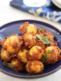 Spicy Bombay potatoes  Baby pearl potatoes- 250 gms (washed and scrubbed well)  Red onion- 1 large  Ginger paste- 1/2 tbsp  Garlic paste- 1/2 tbsp  Coriander powder- 1 tsp  Chilli powder- 1/4 tsp  Turmeric powder- 1/8th tsp  Cumin powder- 1/2 tsp  Tomato- 1 small (optional)  Garam masala- 1/4 tsp  Mustard seeds- 1/4 tsp  Curry leaves- a sprig (optional)  Oil- 1 tbsp  Salt- to taste