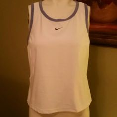 Nike Dri-fit tank top This is a great Nike Dri-fit tank top perfect for running or working out at the gym. Mesh panels at the sides and running down the back to help keep you cool Polyester and spandex, machine wash. Nike Tops Tank Tops