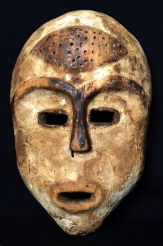 NYANGA MASK This mask originates from Tanzania and and it was  worn during the initiation of young men among the Bira culture.