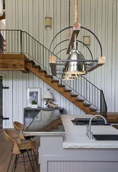 Kitchen island and lighting and that staircase is nice too.