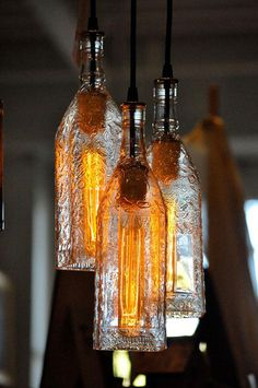 4.) Using old bottles as shades for pendant lamps.