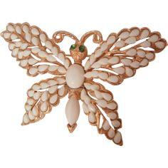 Gorgeous Florenza milk glass emerald color eyes Butterfly brooch is in mint condition. The open cut work wings are covered small white pear shaped