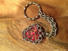 Donna Heffernan Chain Maille Guitar pick bezel (instructions in a copy of 'Art Jewellery' magazine, c2008). The tut is for a necklace, but I made a key ring :)