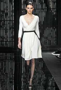 Kendall Jenner walked the runway in a white wrap dress at the Diane von Furstenberg fall 2015 fashion show on Feb. 15, in NYC.