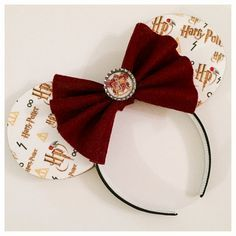 Harry Potter.... enough said. These ears are covered in a Potter-TASTIC printed fabric completed with Swarovski accented Golden Snitches. They are