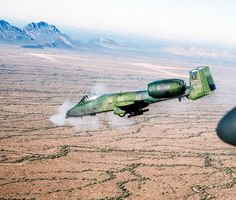 An air-to-air left side view of an Thunderbolt II aircraft of the Tactical Air Support Squadron firing it's Avenger cannon at a target on the East Tactical Range in Southern Arizona × Military Jets, Military Aircraft, Gi Joe, A10 Warthog, Close Air Support, Aviation News, Military Pictures, Air Force, Fighter Jets