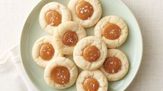 NEW Salted Caramel Thumbprint Cookies - The creamy, soft salted caramel filling nestled in the middle of these sugar cookies is so good, you'll never want to make thumbprints any other way.