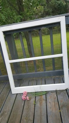 This Vintage two pane window was salvaged from a house built in 1950s. ONE SIDE OF THIS WINDOW IS BLACK AND CHIPPY WITH THE UNDERLYING RED COMING THROUGH, THE OTHER IS NATURALLY WEATHERED. Constructed of solid wood. Very rustic and weathered for a beautiful chippy shabby look. In very worn condition, not perfect. It may have some small dents and chips, as you can see in the pictures. All of the glass in the frame is in perfect condition. Uncleaned due to what you may want to use this for…