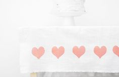 Linen tablecloth with fabric transfer hearts.....do with potato stamping instead???