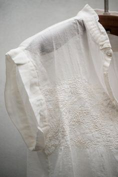 Gently ruffled white cotton
