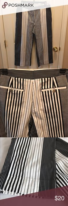 Chico's Black/White Striped Capris/Resort Wear Darling Capri Pants in mint condition. 68% cotton, 28% rayon, 4% spandex.  Cuffed legs. Chico's size 1 converts to a Missy's medium (size 8). Size chart in photos. Chico's Pants Capris