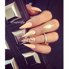 Stilletto nails peach or pink nails with gold
