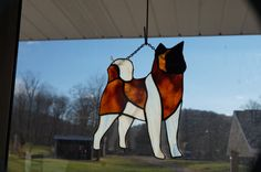 This is a beautiful stained Glass Akita Dog that can be customized to match your favorite pooch. Just send me a picture and we will replicate your pet in glass. He measures approximately 8 x 9.