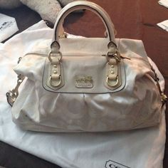 Coach bag Cute coach bag.. Beige / ivory color . Has small stain . Mid condition ..Needs a new home Coach Bags