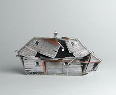 Ofra Lapid / The series Broken houses is based on photographs of abandoned structures neglected by man and destroyed by the weather. The photos are found in the web while pursuing an amateur photographer from North Dakota who obsessively documents the decaying process of these houses. His photographs are used to create small scale models. Afterward, in the studio, the models are photographed again, omitted from their background and placed in gray.