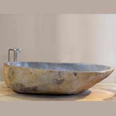 contemporary bathroom with sleek stone tub