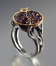 "bygone-age:  johanirae:  twodefenestrate:  everything-that-sweetheart:  ""Pomegranate"" Garnet, Bronze and Silver Ring by Sergey Zhiboedov  And with this I would propose to my lover, asking, ""Will you be co-ruler of the underworld with me?""  Screw diamonds. Propose with something with CLASS and MEANING  Lovely! Imagine, somebody proposing with that, it's like they'd be saying ""You are my Persephone"". Basically, they call you a goddess!"