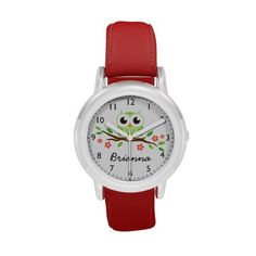 Cute green owl on floral branch wrist watches