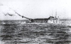 British WWI M1 Firing its guns.A 12-inch gun fired at a relatively short range would have a flat trajectory simplifying aiming, and few ships would be expected to survive a single hit. The 12-inch guns, Mark IX guns were taken from spares for the Formidable-class battleships which were all obsolete by the end of 1919. The mounting in the tower allowed them to elevate by 20 degrees, depress 5 degrees and train 15 degrees in either direction from the centre line.