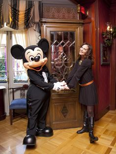 """Lesley Ann Warren Photos Photos - Oscar-nominated actress Lesley Ann Warren poses with Mickey Mouse beside an ornate phone booth adapted from the Disney film, """"The Happiest Millionaire"""", inside Club 33 at Disneyland park on December 29, 2011 in Anaheim, California. Warren made her big screen debut in the 1967 film, which was also Walt Disney?s final live action movie project. - Lesley Ann Warren Visits Disneyland"""