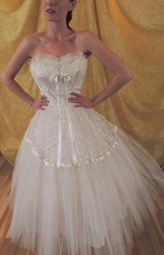 Satin ribbons, tulle and lace. Pure white tea length 1950s prom dress.  Also a perfect wedding dress.